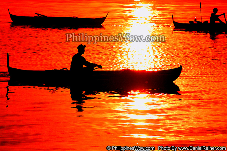 Fishing at sunset in the Philippines