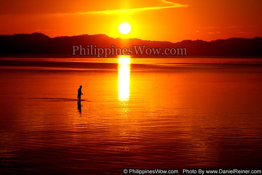 wade fishing at sunset